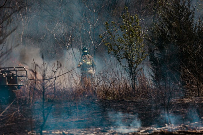 Washington County Emergency Management and Bartlesville Fire Department work together to subdue the brush fire that broke out on Easter. Neighborhood residents noticed smoke hours prior and called 911 after they started seeing flames approach their homes.
