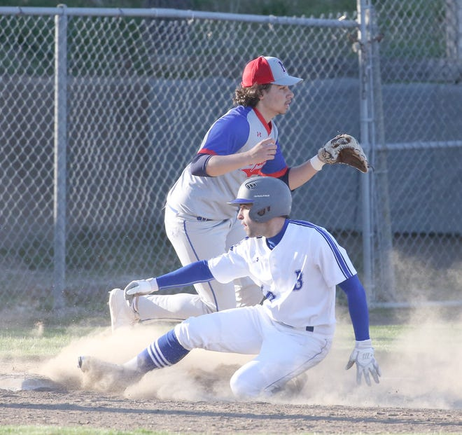 Boonville senior Hunter Pethan completes the slide at third after hitting a triple in the fourth inning Thursday night against Moberly at Twillman field in Harley park. After a 0-2 start to the young season, the Boonville Pirates baseball team picked up its first win by beating the Spartans 7-0.
