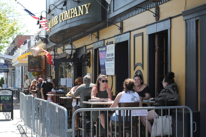 Patrons sit outside the British Beer Company on Main Street in Hyannis. MassDevelopment recently awarded a $30,000 grant to the Downtown Hyannis Community Development Corporation.