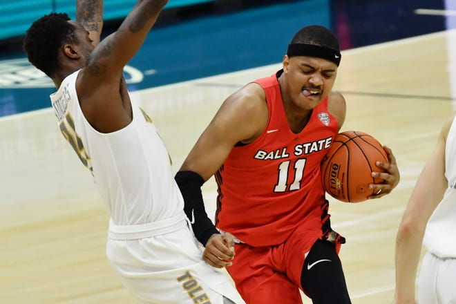 Ball State guard Jarron Coleman (11) drives to the basket against Toledo during a game March 11 at Rocket Mortgage FieldHouse in Cleveland.