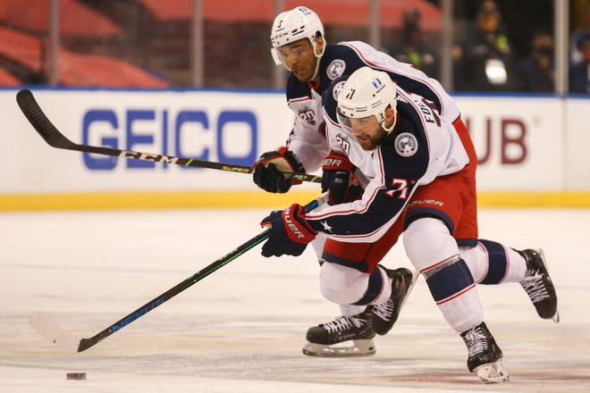 Blue Jackets left wing Nick Foligno, front, skates with the puck against the Panthers during the first period Saturday. Even though they lost 5-2, the Blue Jackets outshot the Panthers 46-39.