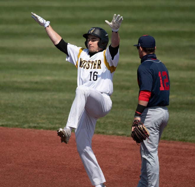 Wooster's Ben Hines has a little bit of fun on the base paths.