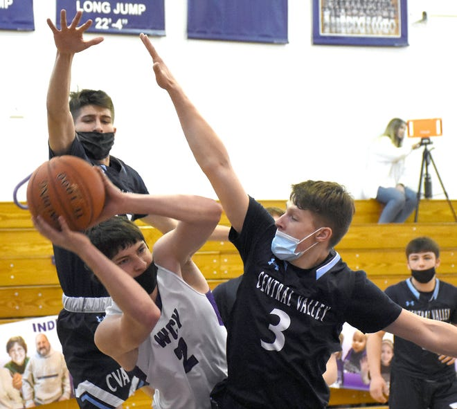 West Canada Valley Indian Will Smith passes out of a double team against Central Valley Academy Saturday. Defending for Central Valley Academy are Adam Hall and Cole Brewer (3).
