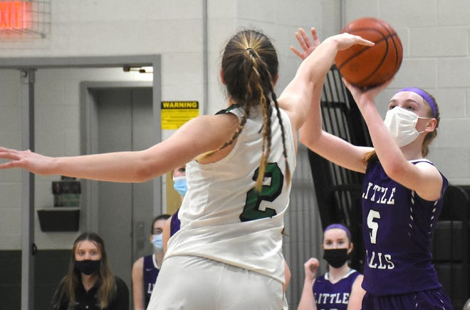 Shayna Straney puts up a shot for Little Falls Friday with Herkimer Magician Ariel Bell (2) defending.