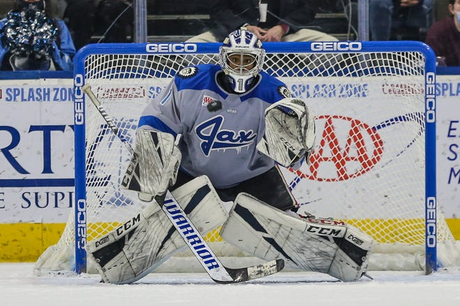 Icemen goaltender Charles Williams saves a shot against Greenville in March. Williams is now eighth in the ECHL in goals-against average.