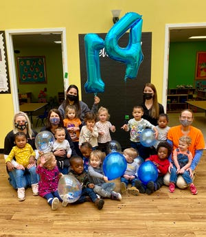 "The New Adventures Early Learning and Child Development Center in Twinsburg took their center's bus to various locations around town and collected over 500 cans with a ""Stuff the Bus"" canned food drive that started during the Thanksgiving holiday and ended during March Mad-Can."