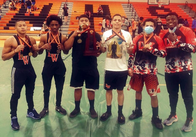 Lake Wales' individual champs from the 2A-11 district meet are, from left,  Regenald Boeur (119), Kamorrion Foster (129), Jessy Garcia (238), Manny Morales (154), Dylan Briggs (169) and head coach Tashawn Williams.