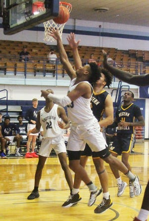 Otero Junior College's Lonnell Martin drives for a layup in Saturday's NJCAA Region IX Tournament game against Western Nebraska. The Rattlers won the game 86-79.