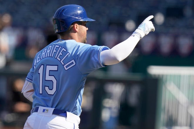 Kansas City Royals Whit Merrifield celebrates his solo home run during the eighth inning of a baseball game against the Texas Rangers at Kauffman Stadium in Kansas City, Mo., Saturday, April 3, 2021.