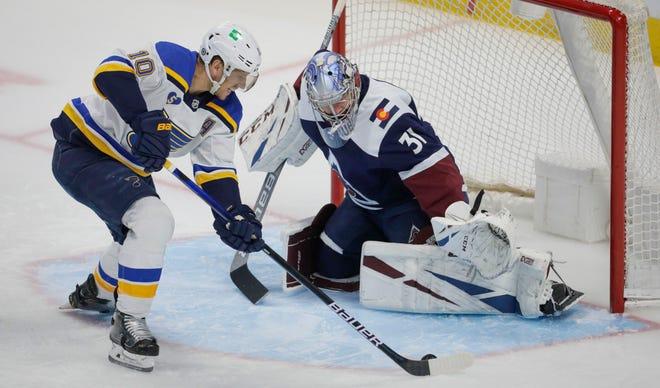 St. Louis Blues center Brayden Schenn (10) shoots on Colorado Avalanche goaltender Philipp Grubauer (31) during the first period of an NHL hockey game in Denver, Saturday, April 3, 2021.