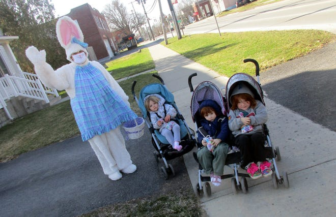 The Easter Bunny visits with, from left, Skilyn Unger, Ivan Unger and Camryn Unger April 3 in front of the Bell Tree in Earlville. The cottontail's visit was hosted by the Earlville Free Library.