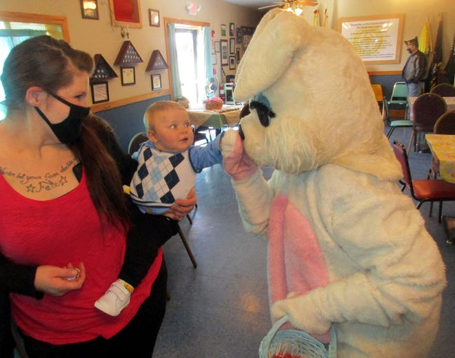 Kolton Campany of Canastota makes a new friend April 3 with mom Alicia Lohr during the Easter Bunny's annual visit to the Munnsville American Legion.
