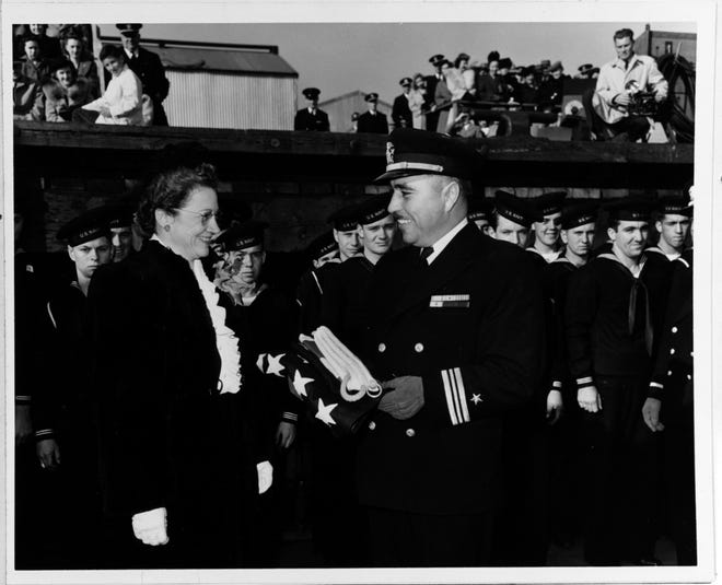 Lt. Cmdr. Ernest E. Evans, USN (1908-1944), is shown at the commissioning ceremony on Oct. 27, 1943, for the USS Johnston (DD-557), in Seattle, Wash. The Johnston's commanding officer, Evans was lost with the ship when it sank during the Battle off Samar Island in the Philippines on Oct. 25, 1944.