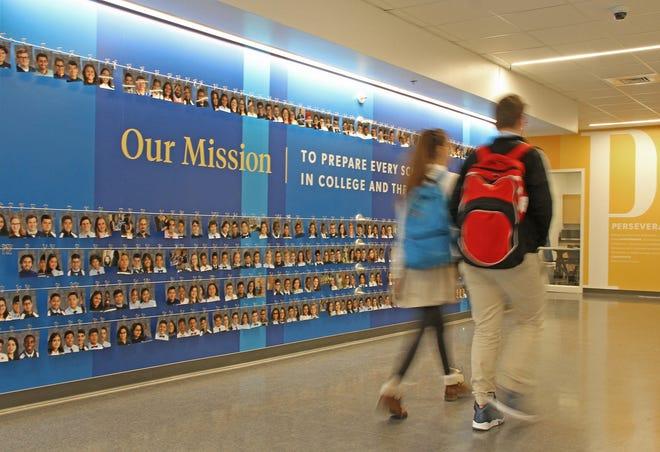 Students walk down a hallway at Blackstone Valley Prep's high school in Cumberland.
