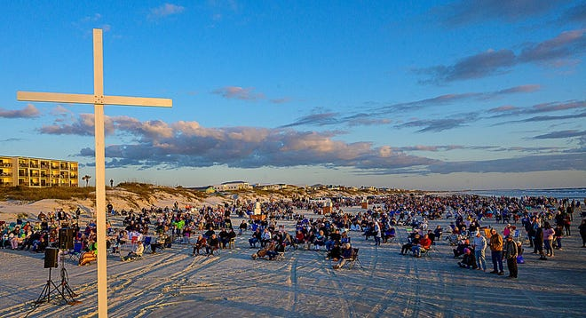 People worship on Crescent Beach during the Crescent Beach Baptist Church's annual Easter sunrise service on Sunday. The annual event, led by Dr. David Beauchamp, the church's senior pastor, was canceled last year because of COVID-19.