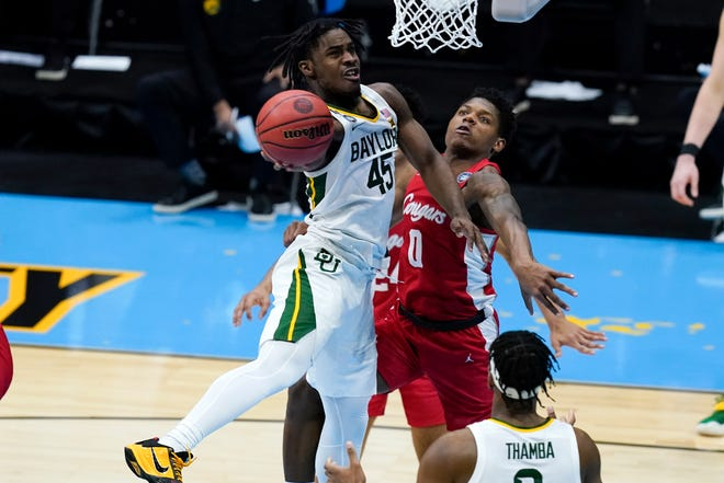 Baylor guard Davion Mitchell (45) of Hinesville shoots over Houston guard Marcus Sasser (0) during the men's Final Four on Saturday at Lucas Oil Stadium in Indianapolis. Mitchell collected 12 points and 11 assists as the Bears won 78-59.