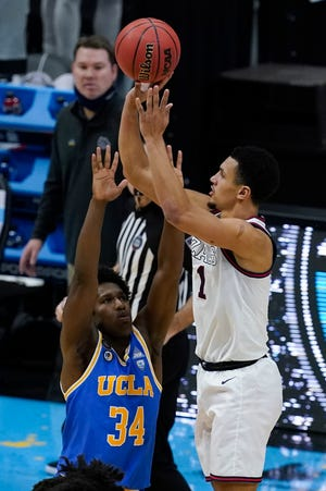 Gonzaga guard Jalen Suggs (1) shoots over UCLA guard David Singleton (34) to win the game during overtime in a men's Final Four NCAA college basketball tournament semifinal game, Saturday at Lucas Oil Stadium in Indianapolis. Gonzaga won 93-90.