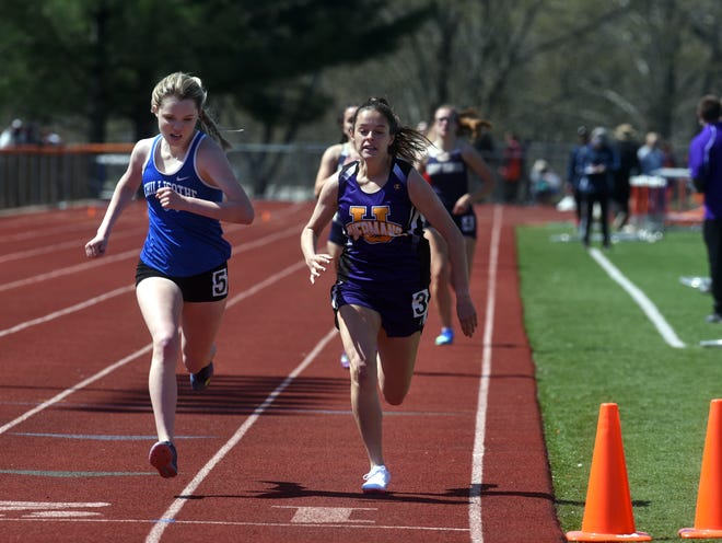 Chillicothe's Liv Janes, left, edges out Unioto's Abi Seals in the 800 meters at the annual Rocky Boots Invitational on Saturday at Nelsonville-York High School.