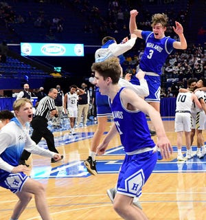 Sam Vinson (3) of Highlands joins his fellow Bluebirds in jubilation upon winning the state championship at the 2021 KHSAA State Boys Basketball Championship, April 3, 2021.