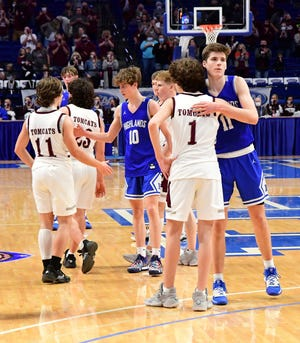 Honor in victory for the Bluebirds --Zachary Barth (10) and Luke Muller (110 of Highlands congratulate Ashland Blazer in their efforts in the semifinals at the 2021 KHSAA State Basketball Championships, April 3, 2021.