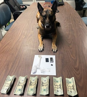 K-9 officer Chili with drugs, drug related items and cash found in a search from a traffic stop overnight Sunday.