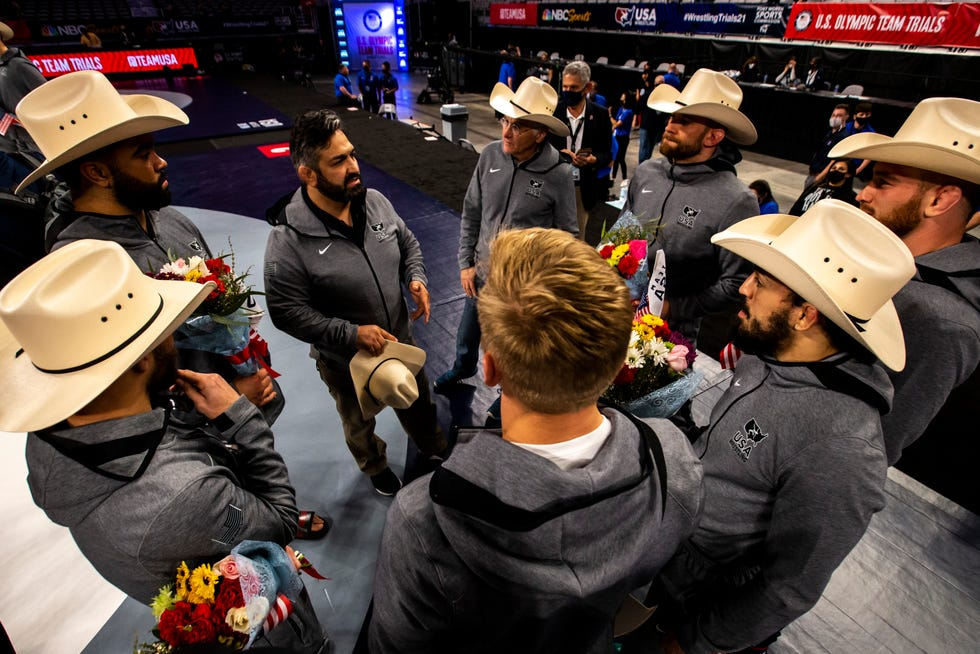 U.S. Olympic men's freestyle coach Bill Zadick talks with wrestlers after the finals during the fourth session of the USA Wrestling Olympic Team Trials, April 3 at Dickies Arena in Fort Worth, Texas.