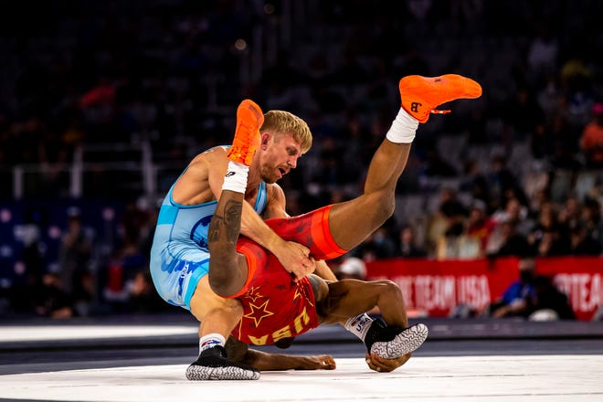 Kyle Dake, left, wrestles Jordan Burroughs in the men's freestyle 74-kilogram finals at the USA Wrestling Olympic Team Trials on April 3 at Dickies Arena in Fort Worth, Texas.