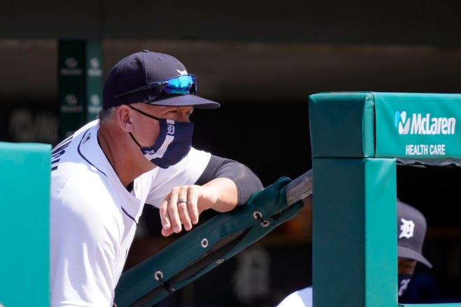 Detroit Tigers manager A.J. Hinch watches from the dugout during the second inning.