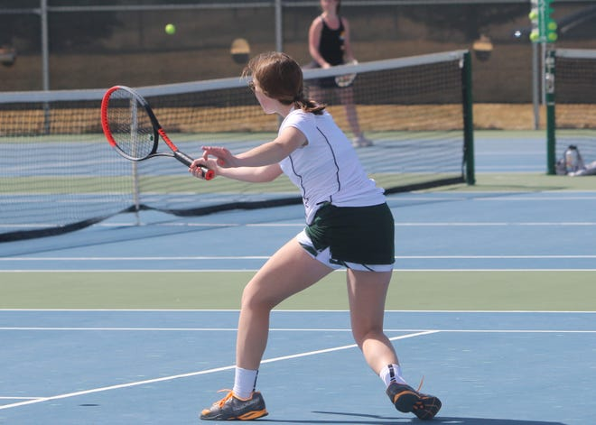 Kiera Richards, C.M. Russell's No. 3 singles player, sends a forehand shot back to Kate Finneman of Billings West Saturday at the CMR tennis courts. Richards won the match, 6-4, 6-3.
