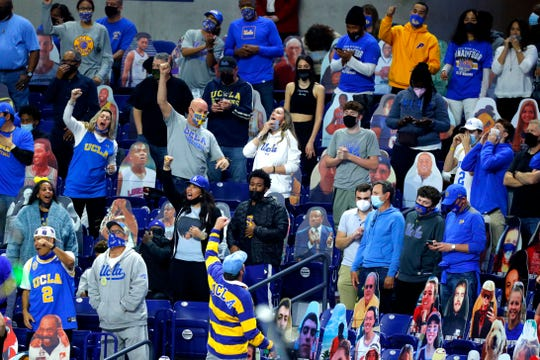 UCLA fans cheer as their team takes on Gonzaga during the Final Four round of the 2021 NCAA Tournament on Saturday, April 3, 2021, at Lucas Oil Stadium in Indianapolis, Ind.