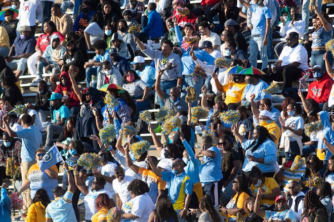Southern fans celebrate when the Jaguars put more points on the scoreboard against longtime rivals Jackson State University during a nonconference game at Veterans Memorial Stadium in Jackson, Miss., Saturday, April 3, 2021.