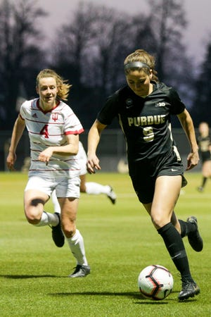 Purdue midfielder Aly Mielke (9) dribbles the ball down the pitch during the second half of an NCAA women's soccer game, Saturday, April 3, 2021 at Folk Field in West Lafayette.