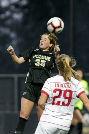 Purdue forward Sarah Griffith (35) goes up for a header during the second half of an NCAA women's soccer game, Saturday, April 3, 2021 at Folk Field in West Lafayette.