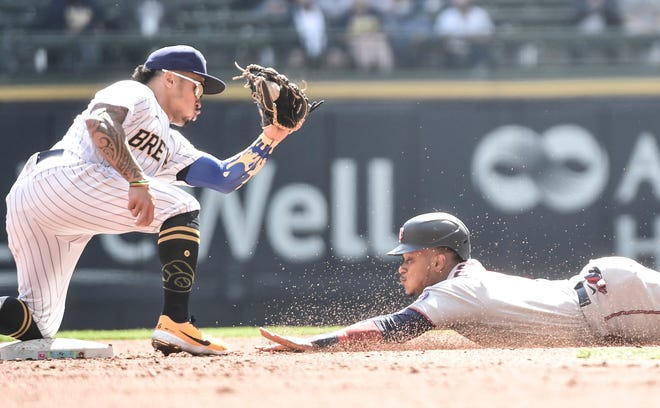 Brewers second Kolten Wong gets ready to tag out Jorge Polanco of the Twins on a steal attempt in the third inning.