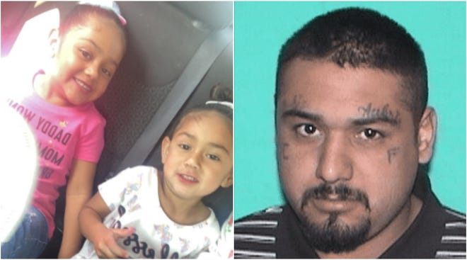 Adelina Lujan, 4, and Aubri Lujan, 3; and their father Jose Luis Lujan.
