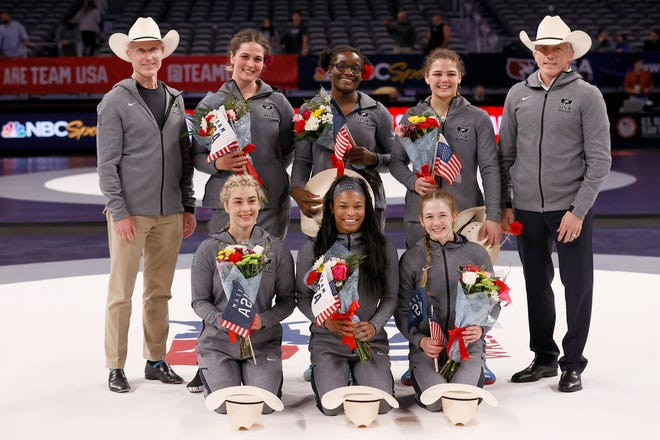 FORT WORTH, TEXAS - APRIL 03: Women's Freestyle winners and coaches pose for a photo at the conclusion of the U.S. Olympic Wrestling Team Trials at Dickies Arena on April 03, 2021 in Fort Worth, Texas. (Photo by Tom Pennington/Getty Images)