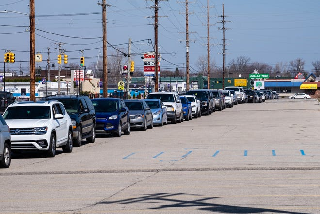 Vehicles line up before a COVID-19 testing clinic on Easter Sunday, April 4, 2021, at Memorial Stadium in Port Huron.