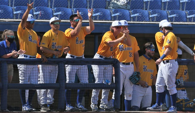 The Angelo State University baseball team celebrates in the dugout during a game earlier in the 2021 season.