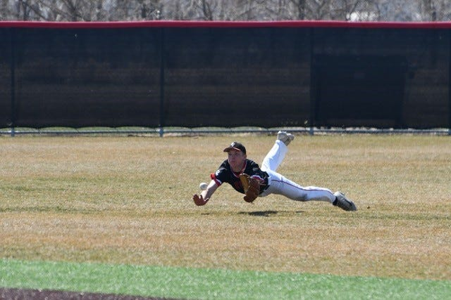 Brandon Valley centerfielder Luke Kocer dives to make a catch on Friday, April 2, 2021. The Lynx defeated Madison in both games of a double-header.