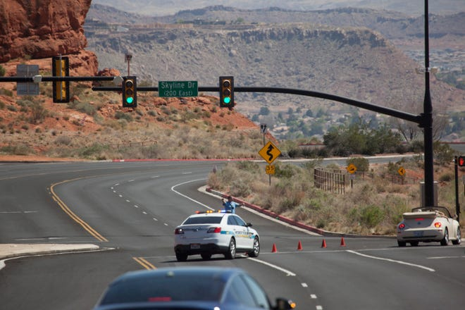 Law enforcement officials block off Red Hills Parkway and respond to a man with a gun near the water tank Sunday, April 4, 2021.