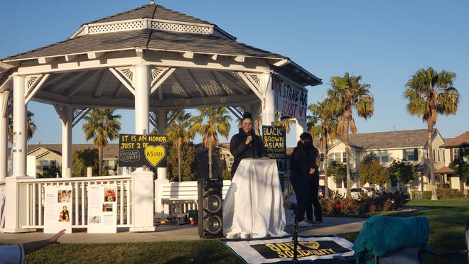 Opening speaker Alice Chou addresses the crowd during a candlelight vigil honoring the victims of anti-Asian American violence Saturday, April 3, 2021, at Central Park in Oxnard's Riverpark neighborhood.