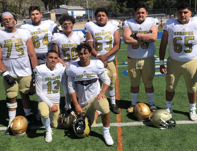 Quarterback Manny Rosales and running back Justin Cantu (kneeling left to right) pose with their offensive linemen (back row left to right) Ruben Cortez, Jackson Applegate, Mani Duran, Cameron Galvan, Kayden Brewer, and Robert Hernandez after the Seraphs dominated host Westlake on Saturday afternoon.