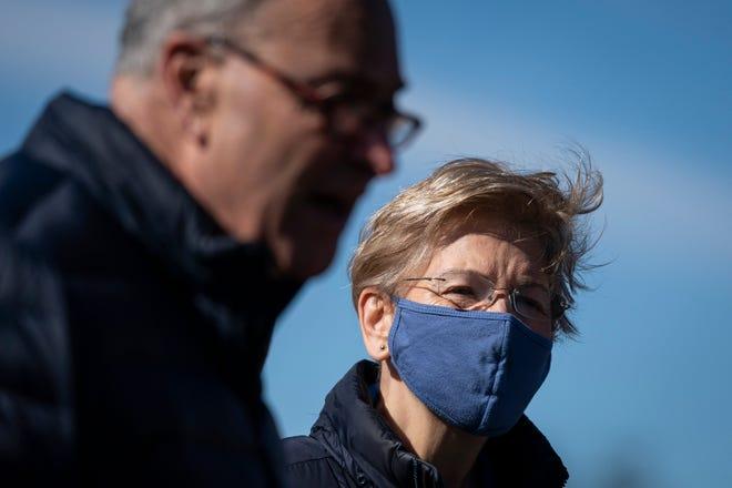 Senate Majority Leader Chuck Schumer and Sen. Elizabeth Warren, D-Mass., at a news conference about student debt on Feb. 4, 2021, in Washington, D.C.