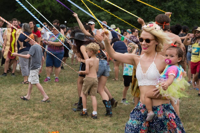 Ashley Heck and Ivy Hernandez danced around the maypole during Eeyore's Birthday in Pease Park in 2017.
