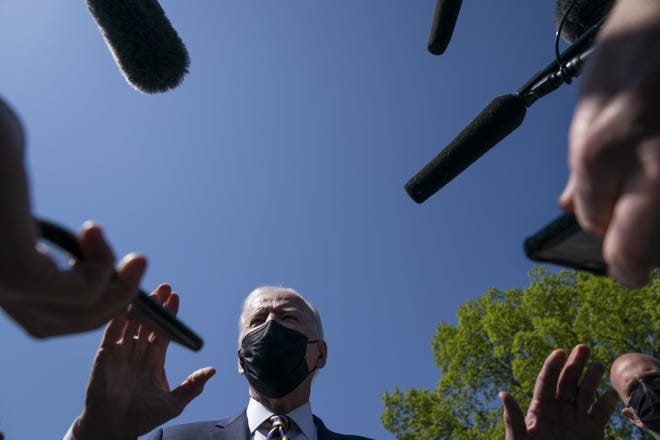 President Joe Biden talks with reporters on the Ellipse on the National Mall after spending the weekend at Camp David, Monday in Washington. [AP Photo/Evan Vucci]