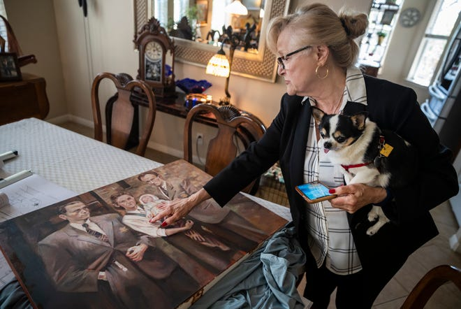 Lucy Katz displays a painting of her family Monday at her Austin home. Katz was an infant when she was saved during the Holocaust, and she continues to share her story as a way to talk about hate and genocide in the world.