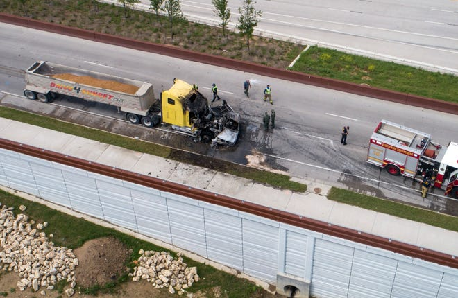 Police and firefighters respond to a fatal accident at the corner of Ed Bluestein Boulevard (U.S. 183) and Loyola Lane on Monday April 5, 2021.   Medics said the 18-wheeler and a second vehicle involved were both on fire when they arrived and one driver was trapped inside the vehicle.  About 18 minutes later, medics said they were able to extract the driver from the vehicle. The driver, who has not been identified, was pronounced dead at the scene. The second driver refused medical care.