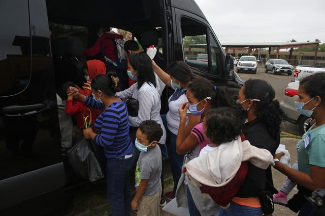 Migrants board a van at Our Lady of Guadalupe Catholic Church in Mission, Texas, on Palm Sunday, March 28, 2021. U.S. authorities are releasing migrant families at the border without notices to appear in immigration court and sometimes, without any paperwork at all.