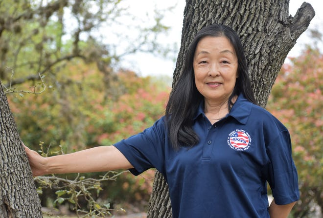 Local Asian-American activist Alice Yi, pictured at her home, said she is trying to educate her community to report acts of racial hatred.