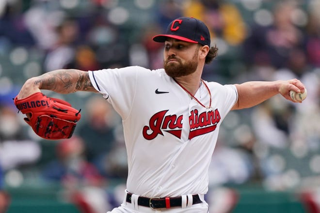 Cleveland starting pitcher Logan Allen delivers in the first inning of a baseball game against the Kansas City Royals, Monday, April 5, 2021, in Cleveland. (AP Photo/Tony Dejak)